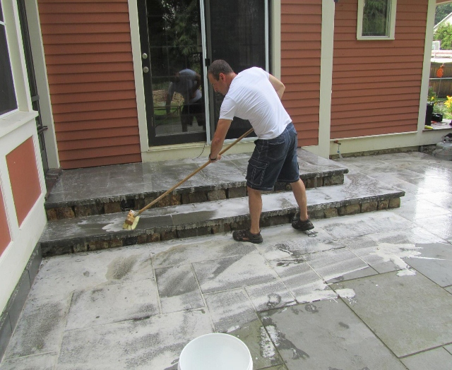 How to clean a patio without a pressure washer how to for Deck and concrete cleaner