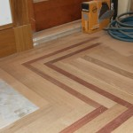 Hardwood floor border and inlay
