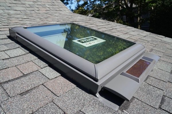 Replacing skylights when re roofing a concord carpenter for Velux solar skylight tax credit